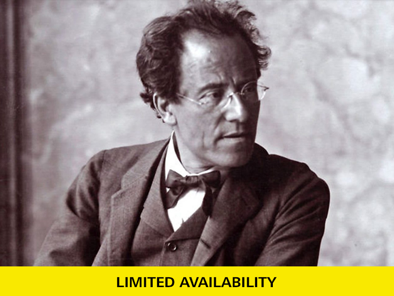 Close up of Gustav Mahler, wearing a dark suit and glancing to his left.